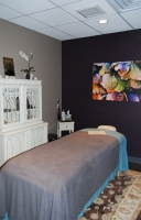 Relaxing, beautiful massage room at the Beauty Collective Salon in Birmingham, Michigan.